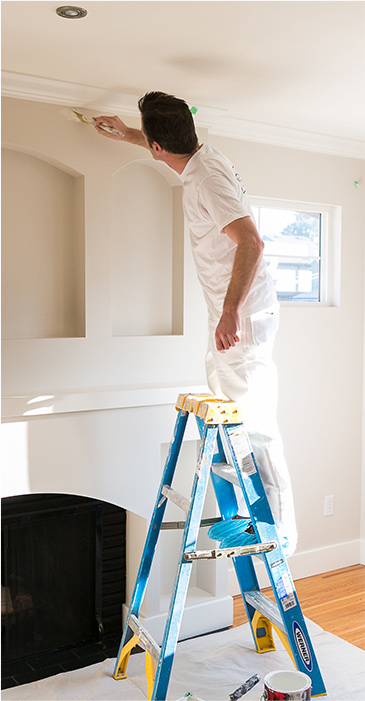 professional painter painting a home's interior